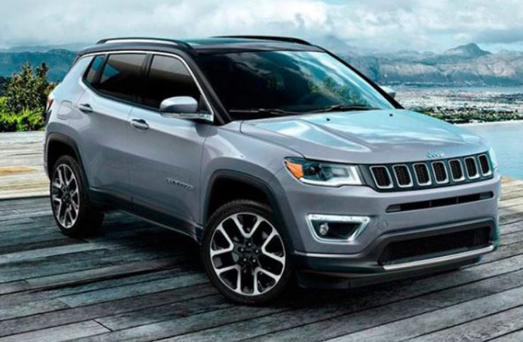 Image of a gray Jeep Compass parked on a dock.